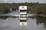 Coastal flooding from high tide on A12 trunk road at Blythburgh, Suffolk, England