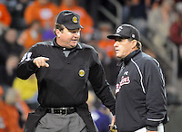 Head coach Ray Tanner (1) of the South Carolina Gamecocks talks with home plate umpire Scott Erby during a game against the Clemson Tigers on Tuesday, March 8, 2011, at Fluor Field in Greenville, S.C. USC won 5-4.  Photo by Tom Priddy / Four Seam Images
