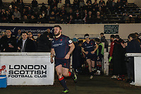 London Scottish players enter the field of play ahead of the Greene King IPA Championship match between London Scottish Football Club and Jersey Reds at Richmond Athletic Ground, Richmond, United Kingdom on 16 March 2018. Photo by David Horn.
