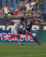 New England Revolution forward Zack Schilawski (15) attempts to receive a pass as Chicago Fire defender Wilman Conde (22) defends. The Chicago Fire defeated the New England Revolution, 1-0, at Gillette Stadium on June 27, 2010.