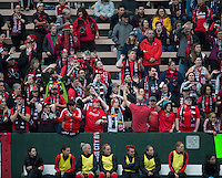 Seattle, WA - Saturday, May 14, 2016: Portland Thorns FC  fans cheer on their team. The Portland Thorns FC and the Seattle Reign FC played to a 1-1 tie during a regular season National Women's Soccer League (NWSL) match at Memorial Stadium.