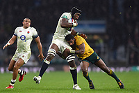 Maro Itoje of England is tackled by Marika Koroibete of Australia. Old Mutual Wealth Series International match between England and Australia on November 18, 2017 at Twickenham Stadium in London, England. Photo by: Patrick Khachfe / Onside Images