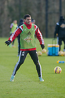 SWANSEA, WALES - JANUARY 28:  Kyle Naughton of Swansea City  waits for the ball during training on January 28, 2015 in Swansea, Wales.