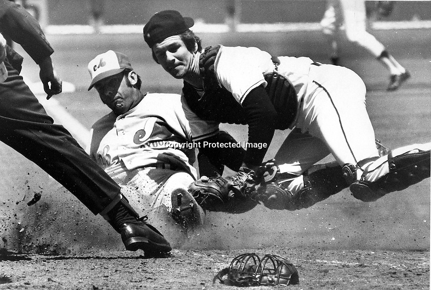Montreal Expo Ron Hunt upends San Francisco Giants catcher Dave Rader but is tagged out at home.<br />
