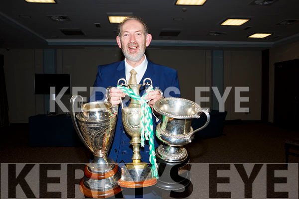 Bobby Thornhill, Ballyduffs senior hurling manager proudly displaying the silverware collected last year at the Ballyduff GAA Social in the Roes Hotel on Saturday night last.