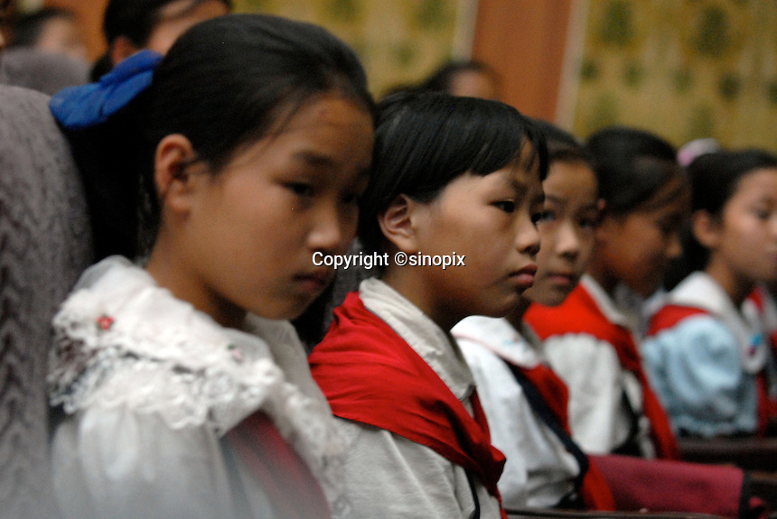 """Children of the privileged at the Children's Palace and School, Pyongyang North Korea. North Korea is one of the last great dictatorships where, """"Dear Leader"""" Kim-Jong-il and his father Kim Il-sung """"Great Leader"""" are worshipped and there is complete control of a people who are constantly reminded of the evil deeds of the west and USA."""