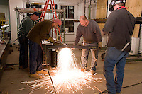 WELDING<br /> Acetylene Torch Welding<br /> Using a gas torch to cut a metal beam.  Sparks fly as the metal melts.  The torch has two hoses, one for the gas and the other for oxygen.