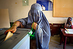 Anar Gula, mother of 11, casts her ballot for President Hamid Karzai in the city of Kandahar, Afghanistan, Thursday, Aug. 20, 2009. Karzai enjoys widespread support in Kandahar, his home province.