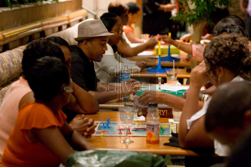 People play games during a Play Date Atlanta event at the Crowne Plaza Ravinia on Ashford Dunwoody Road on Saturday, Sept. 8, 2007. Play Date offers adults diversions ranging from Hungry Hungry Hippo to more traditional card games.