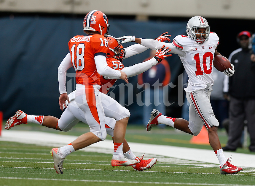 Ohio State Buckeyes wide receiver Philly Brown (10) is forced outof bounds by Illinois Fighting Illini linebacker T.J. Neal (52) and Justin DuVernois (18) during the second half of Saturday's NCAA Division I football game at Memorial Stadium in Champaign, Il., on November 16, 2013. Ohio State won the game 60-35. (Barbara J. Perenic/The Columbus Dispatch)