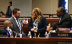 Nevada Assembly Democrats, from left, William Horne, David Bobzien, Marilyn Kirkpatrick, Lucy Flores and Jason Frierson work on the Assembly floor during the final hours of the 77th Legislative session at the Legislative Building in Carson City, Nev., on Monday, June 3, 2013. (AP Photo/Cathleen Allison)