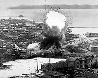 Supply warehouses and dock facilities at this important east coast port feel the destructive weight of para-demolition bombs dropped from Fifth Air Force's B-26 Invader light bombers, Wonsan, North Korea. Ca. 1951.  Air Force. (USIA)<br /> Exact Date Shot Unknown<br /> NARA FILE #:  306-PS-51-10303<br /> WAR &amp; CONFLICT BOOK #:  1443