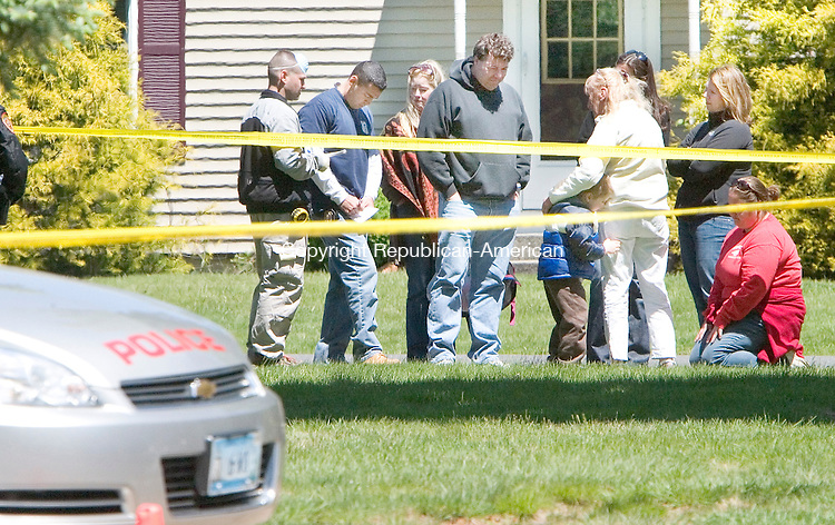 WOLCOTT, CT. 10 May 2010-051010SV06--Officials talk with family and friends as they gather outside the Cannon home at 207 Spindle Hill Road in Wolcott on Monday as Wolcott and state police investigate the disappearance of Cynthia Cannon, who police say was murdered by her husband, Patrick. <br /> Steven Valenti Republican-American
