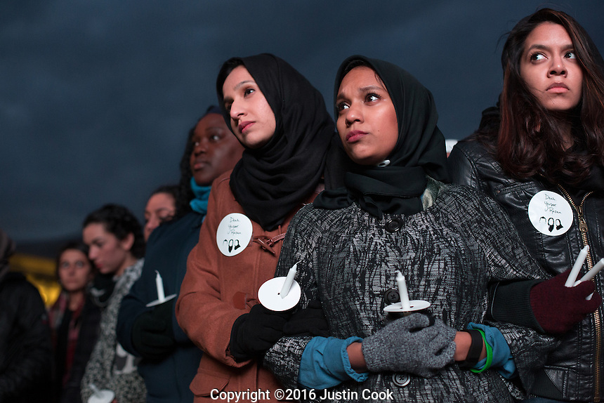 FROM LEFT (ALL CQ):  Raleigh residents Rida Fatima, Mimrah Hossain and Fareeha Mustafa on the one-year anniversary of the murder Deah Barakat, his wife Yusor Mohammad Abu-Salha and her sister Razan Mohammad Abu-Salha. A vigil was held in their honor at North Carolina State University in Raleigh, NC on Wednesday, February 10, 2016. (Justin Cook)