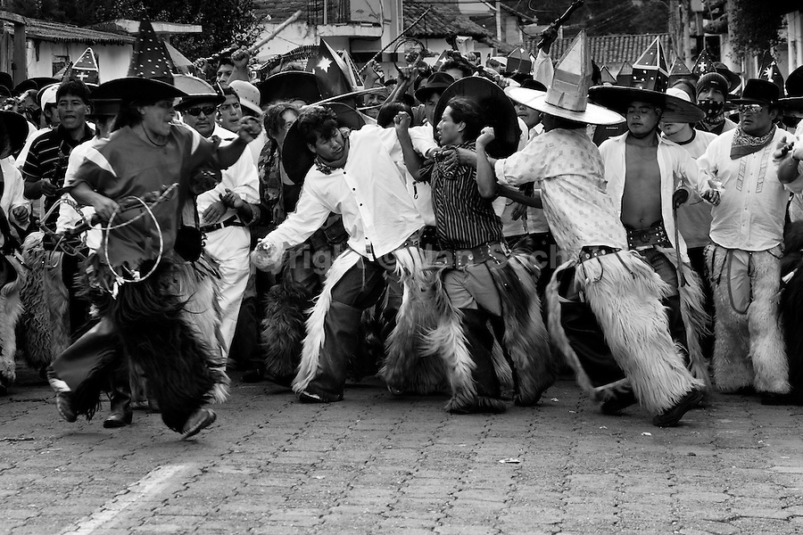 Indians, wearing goatskin chaps, fight furiously during the Inti Raymi (San Juan) festivities in Cotacachi, Ecuador, 29 June 2010. 'La toma de la Plaza' (Taking of the square) is an ancient ritual kept by Andean indigenous communities. From the early morning of the feast day, various groups of San Juan dancers from remote mountain villages dance in a slow trot towards the main square of Cotacachi. Reaching the plaza, Indians start to dance around. They pound in synchronized dance rhythm, shout loudly, whistle and wave whips, showing the strength and aggression. Dancers from either the upper communities (El Topo) or the lower communities (La Calera), joined in respective coalitions, seek to conquer and dominate the square and do not let their rivals enter. If not moderated by the police in time, the high tension between groups always ends up in violent clashes.