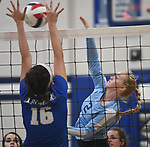 Marquette's Claire Spain (left) defends as Jerseyville's Sally Hudson slams the ball over. Jerseyville played at Alton Marquette in a girls volleyball game on Wednesday September 11, 2018.<br /> Tim Vizer/Special to STLhighschoolsports.com