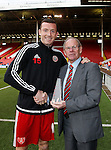 Neill Collins of Sheffield Utd receives a memento of his 200th club appearance - FA Cup Second round - Sheffield Utd vs Oldham Athletic - Bramall Lane Stadium - Sheffield - England - 5th December 2015 - Picture Simon Bellis/Sportimage