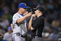 Durham Bulls manager Jared Sandberg (22) argues a call with first base umpire Brian Peterson during the game against the Charlotte Knights at BB&T BallPark on May 15, 2017 in Charlotte, North Carolina. The Knights defeated the Bulls 6-4.  (Brian Westerholt/Four Seam Images)