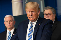 United States President Donald J. Trump makes remarks as he participates in a news briefing by members of the Coronavirus Task Force in the Brady Press Briefing Room at the White House in Washington, DC on Monday, March 23, 2020. At left is US Vice President Mike Pence.<br /> Credit: Chris Kleponis / Pool via CNP/AdMedia