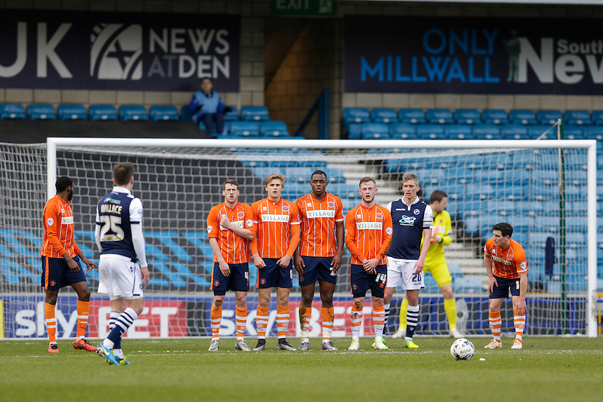 Blackpool players form a defensive wall for a free kick (from which they conceded the second goal)<br /> <br /> Photographer Craig Mercer/CameraSport<br /> <br /> Football - The Football League Sky Bet League One - Millwall v Blackpool - Saturday 5th March 2016 - The Den - Millwall<br /> <br /> &copy; CameraSport - 43 Linden Ave. Countesthorpe. Leicester. England. LE8 5PG - Tel: +44 (0) 116 277 4147 - admin@camerasport.com - www.camerasport.com