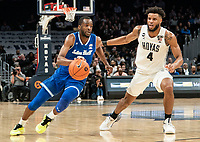 WASHINGTON, DC - FEBRUARY 05: Quincy McKnight #0 of Seton Hall dribbles past Jagan Mosely #4 of Georgetown during a game between Seton Hall and Georgetown at Capital One Arena on February 05, 2020 in Washington, DC.