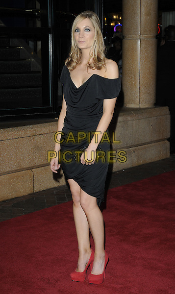 """JOANNE FROGGATT.54th BFI London Film Festival screening of """"In Our Name"""" at Vue cinema, Leicester Square, London, England, UK, October 15th 2010..full length dress red suede platform shoes cleavage ruched clutch bag black off the shoulder .CAP/CAN.©Can Nguyen/Capital Pictures."""