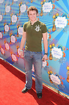 SANTA MONICA, CA. - March 14: Nick Purcell attends the Make-A-Wish Foundation's Day of Fun hosted by Kevin & Steffiana James held at Santa Monica Pier on March 14, 2010 in Santa Monica, California.