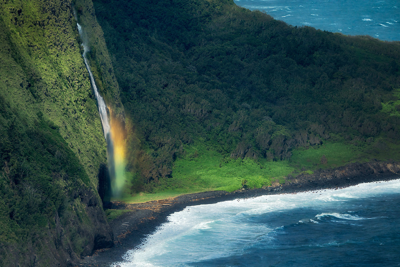 Small unnamed waterfall with rainbow. Waipio Valley Overlook. Hawaii, The Big Island