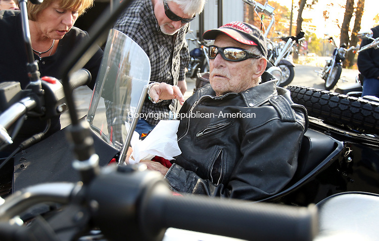 WOLCOTT CT. 02 November 2016-110216SV09-Ernest Sherman catches a ride in the side car with Dave Blankschen of Wolcott during warmer than normal weather in Wolcott Wednesday.  Friends and relatives took 92-year-old Sherman, a Marine, on one last bike ride. <br /> Steven Valenti Republican-American