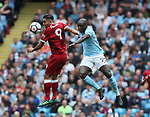 Roberto Firmino of Liverpool challenges Benjamin Mendy of Manchester City during the premier league match at the Etihad Stadium, Manchester. Picture date 9th September 2017. Picture credit should read: David Klein/Sportimage