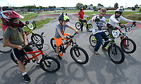 James Stevenson of Rogers (right), who has been riding since 1974, speaks to a group of riders Saturday, Aug. 1, 2020, during a workshop led by Stevenson at the pump track at Runway Bike Park at The Jones Center in Springdale. Stevenson and several local riders spent the morning teaching young riders how to navigate the pump track and how to position themselves on their bicycles. Visit nwaonline.com/200803Daily/ for today's photo gallery.<br /> (NWA Democrat-Gazette/Andy Shupe)