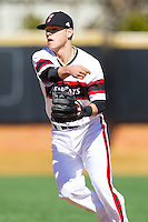 Cincinnati Bearcats second baseman Colin Hawk (2) follows through on a throw to first base against the Radford Highlanders at Wake Forest Baseball Park on February 22, 2014 in Winston-Salem, North Carolina.  The Highlanders defeated the Bearcats 6-5.  (Brian Westerholt/Four Seam Images)