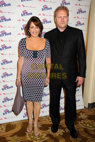 "PATRICIA HEATON & DAVID HUNT .BritWeek 2010 Charity Event: ""Save The Children and Virgin Unite"" held at the Beverly Wilshire Hotel, Beverly Hills, California, USA, 22nd April 2010..full length pink polka dot blue navy dress pattern husband wife couple black suit tie shirt brown tan beige platform sandals bag woven purple .CAP/ADM/BP.©Byron Purvis/AdMedia/Capital Pictures."