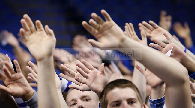 Kentucky fans wave their hands during the cheer practice at Rupp Arena on Wenesday evening. Photo by Zach Brake | Staff