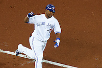 Toronto Blue Jays outfielder Edwin Encarnacion #10 rounds third after hitting a home run during an American League game against the Seattle Mariners at the Rogers Centre on September 13, 2012 in Toronto, Ontario.  Toronto defeated Seattle 8-3.  (Mike Janes/Four Seam Images)