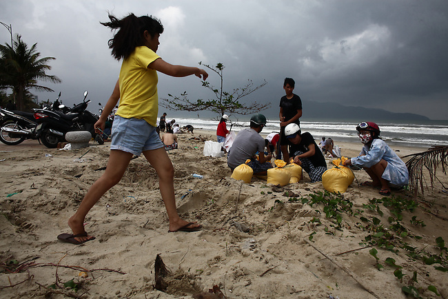 Residents in Da Nang, Vietnam fill sandbags on Saturday  in preparation for Super Typhoon Haiyan, which is expected to hit the city on around 4 a.m. Sunday morning. Local authorities announced they had evacuated 20,000 people from vulnerable areas and advised others to stay inside their homes.