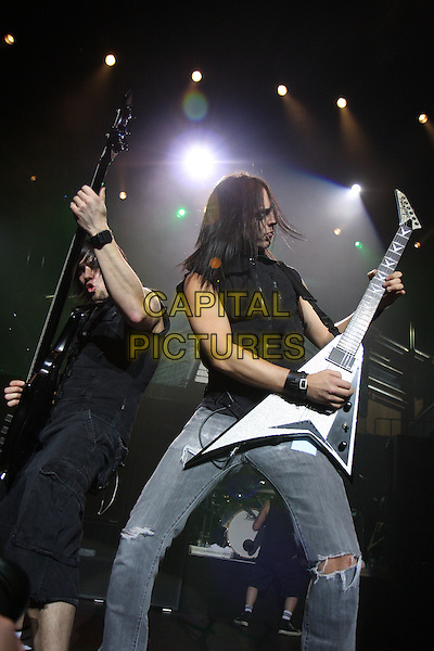 "BULLET FOR MY VALENTINE - Jason ""Jay"" James & Matthew ""Matt"" Tuck.Live in concert at the Royal Albert Hall as part of the TCT gigs, London, England..April 28th, 2009.stage gig performance music half length 3/4 jeans denim black sleeveless top guitar .CAP/MAR.© Martin Harris/Capital Pictures."