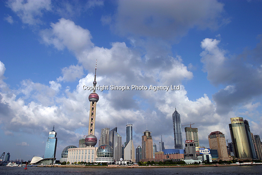 The super modern skyline seen from the Huangpu River  in Shanghai, China. Shanghai is a marval of modern design and architecture but this has come at a high price as tradition and culture are being sacrificed. .