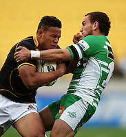 Wellington winger Alapati Leuia tries to bump off Aaron Cruden. Air NZ Cup - Wellington Lions v Manawatu Turbos at Westpac Stadium, Wellington, New Zealand. Saturday 3 October 2009. Photo: Dave Lintott / lintottphoto.co.nz