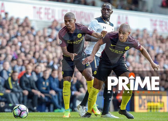 L-R Manchester City's Fernandinho and Manchester City's Fernando<br /> during the Premier League match between Tottenham Hotspur and Manchester City at White Hart Lane, London, England on 2 October 2016. Photo by Kieran  Galvin / PRiME Media Images.