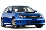Low aggressive passenger side front three quarter view of a 2009 Subaru Impreza Wagon WRX.
