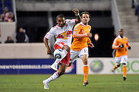 Juan Agudelo (17) of the New York Red Bulls is chased by Mike Chabala (17) of the Houston Dynamo. The New York Red Bulls  and the Houston Dynamo played to a 1-1 tie during a Major League Soccer (MLS) match at Red Bull Arena in Harrison, NJ, on April 02, 2011.