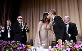 United States President Barack Obama kisses First Lady Michelle Obama after he speaks during the White House Correspondents' Association annual dinner on April 30, 2016 at the Washington Hilton hotel in Washington.This is President Obama's eighth and final White House Correspondents' Association dinner.<br /> Credit: Olivier Douliery / Pool via CNP