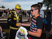 Jun. 1, 2014; Englishtown, NJ, USA; NHRA top fuel driver Richie Crampton is congratulated by a fan as he celebrates after winning the Summernationals at Raceway Park. Mandatory Credit: Mark J. Rebilas-