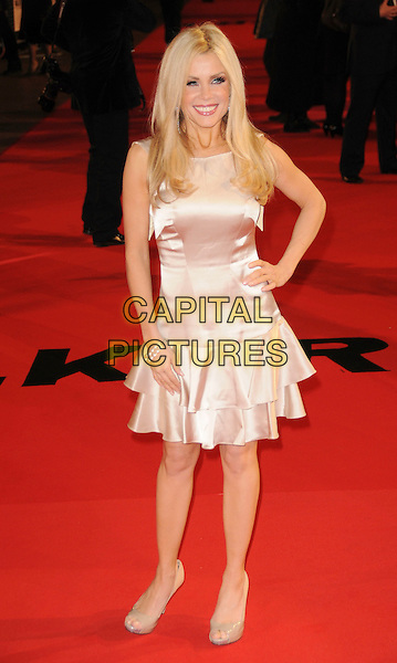 "MELINDA MESSENGER .At the UK Film Premiere of ""Valkyrie"", Odeon Leicester Square, London, England, January 21st 2009..full length cream silk satin pale pink dress tiered bare legs beige shoes peep open toe hand on hip.CAP/CAS.©Bob Cass/Capital Pictures"