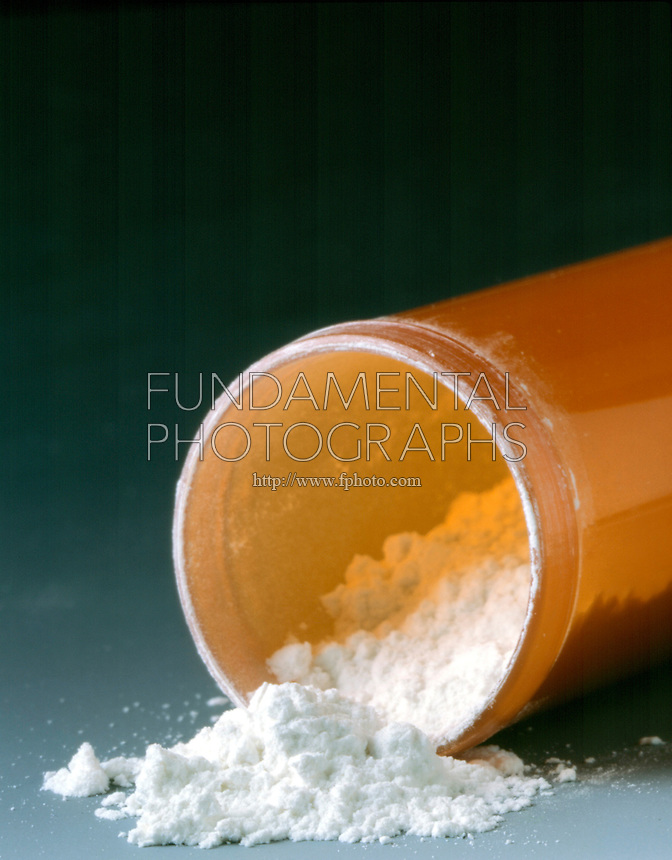 STILL LIFE: NEGATIVE IMAGE OF COCAINE<br /> Pile of Addictive Substance<br /> Cocaine on mirrored surface. Cocaine appearing in powder form is a salt, typically cocaine hydrochloride.