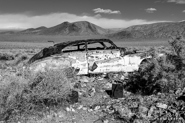 Buick Roadmaster lies abandoned and rusting near Harrisburg and the Eureka Mine in Death Valley National Park.