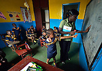 A teacher uses the blackboard to explain a lesson during class in a day care center in Monrovia, Liberia, sponsored by United Methodist Women.