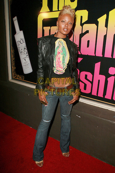 EVA PIGFORD.Ed Hardy Grand Re-Opening of the Melrose Store, Hollywood, California, USA..October 20th, 2006.Ref: ADM/CH.full length jeans denim black leather jacket.www.capitalpictures.com.sales@capitalpictures.com.©Charles Harris/AdMedia/Capital Pictures.