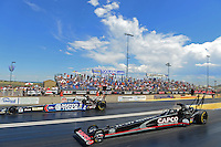 Jul, 22, 2012; Morrison, CO, USA: NHRA top fuel dragster driver Steve Torrence (near lane) races alongside Antron Brown during the Mile High Nationals at Bandimere Speedway. Mandatory Credit: Mark J. Rebilas-